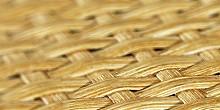 Мебельные плиты на основе МДФ или сотовой плиты покрытые наружным слоем плетения из ротанга.